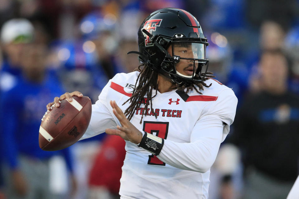 Texas Tech quarterback Jett Duffey passes to a teammate during the first half of an NCAA college football game against Kansas in Lawrence, Kan., Saturday, Oct. 26, 2019. (AP Photo/Orlin Wagner)