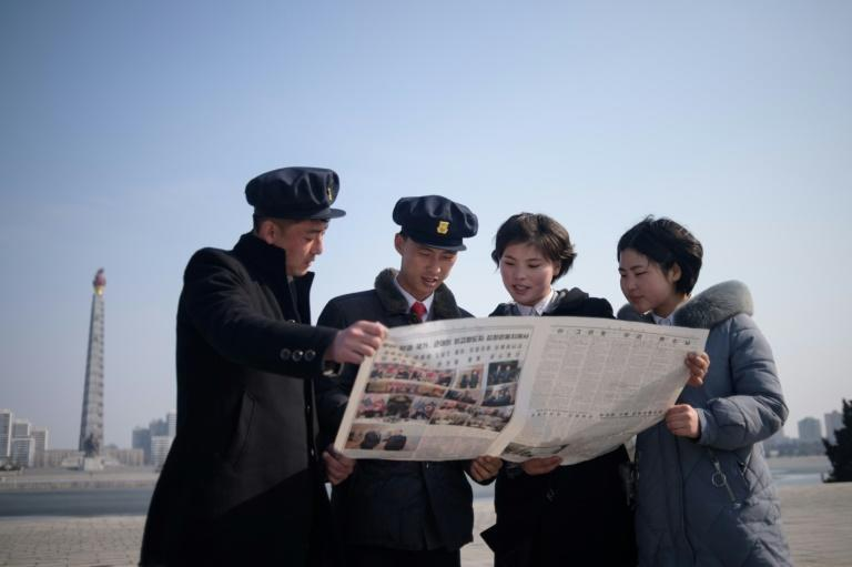 North Korean students read newspaper coverage of Kim Jong Un's summit with US President Donald Trump