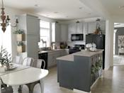 """<p>The use of two tones of gray pop beautifully in this kitchen, proving that paint can make a huge difference in any space.</p><p><strong>Get the tutorial at <a href=""""https://www.snazzylittlethings.com/budget-kitchen-remodel-cabinet-paint/"""" rel=""""nofollow noopener"""" target=""""_blank"""" data-ylk=""""slk:Snazzy Little Things"""" class=""""link rapid-noclick-resp"""">Snazzy Little Things</a>.</strong></p><p><strong><a class=""""link rapid-noclick-resp"""" href=""""https://www.amazon.com/Pro-Grade-Professional-Painting-Commercial-Paintbrush/dp/B07JHQ4L4F/?tag=syn-yahoo-20&ascsubtag=%5Bartid%7C2139.g.34085615%5Bsrc%7Cyahoo-us"""" rel=""""nofollow noopener"""" target=""""_blank"""" data-ylk=""""slk:SHOP PAINT BRUSHES"""">SHOP PAINT BRUSHES</a><br></strong></p>"""
