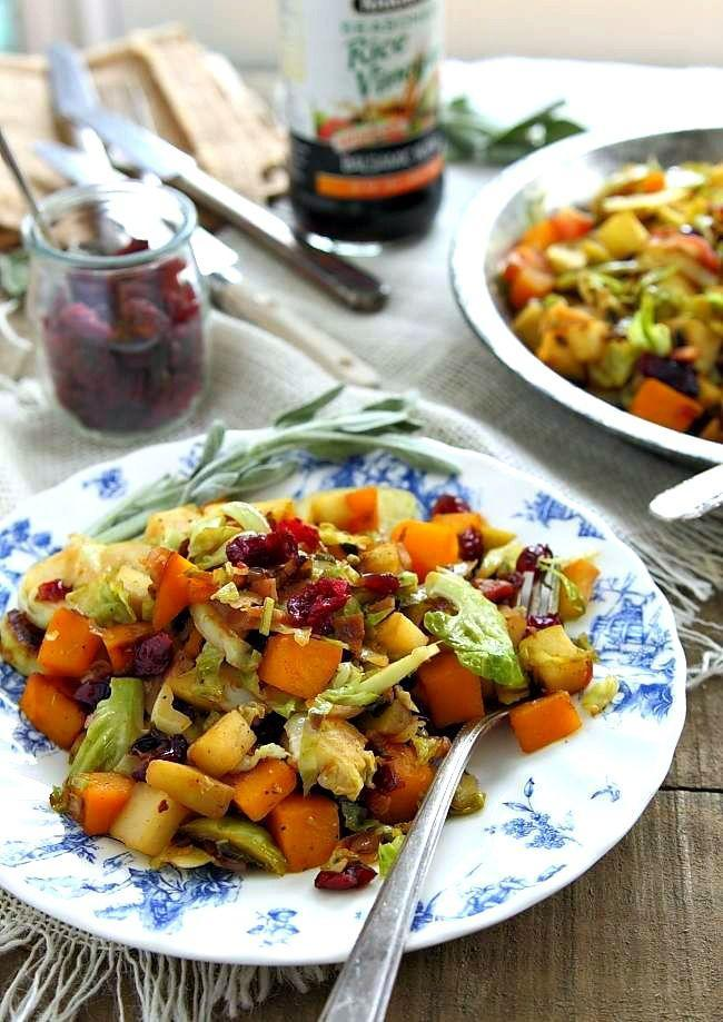 """<p>A hash of apples, pumpkin, chopped bacon, and brussels sprouts makes for a wonderful side dish. Serve with a poached egg for a satisfying main course.</p><p><strong>Get the recipe at <a href=""""http://www.runningtothekitchen.com/brussels-sprouts-pumpkin-and-apple-hash/"""" rel=""""nofollow noopener"""" target=""""_blank"""" data-ylk=""""slk:Running to the Kitchen"""" class=""""link rapid-noclick-resp"""">Running to the Kitchen</a>.</strong></p>"""