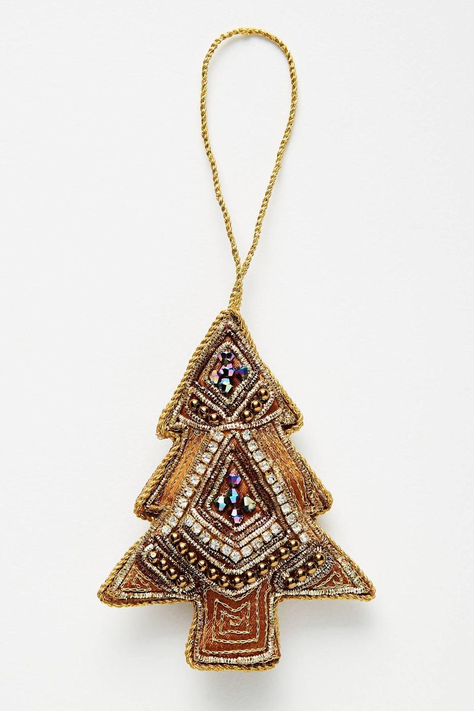 """<p>Who says a tree can't be an ornament, too? The <a href=""""https://www.popsugar.com/buy/Beaded-Golden-Tree-Ornament-490559?p_name=Beaded%20Golden%20Tree%20Ornament&retailer=anthropologie.com&pid=490559&price=12&evar1=casa%3Aus&evar9=46615300&evar98=https%3A%2F%2Fwww.popsugar.com%2Fhome%2Fphoto-gallery%2F46615300%2Fimage%2F46615430%2FBeaded-Golden-Tree-Ornament&list1=shopping%2Canthropologie%2Choliday%2Cchristmas%2Cchristmas%20decorations%2Choliday%20decor%2Chome%20shopping&prop13=mobile&pdata=1"""" rel=""""nofollow noopener"""" class=""""link rapid-noclick-resp"""" target=""""_blank"""" data-ylk=""""slk:Beaded Golden Tree Ornament"""">Beaded Golden Tree Ornament</a> ($12) will sparkle under holiday lights. </p>"""