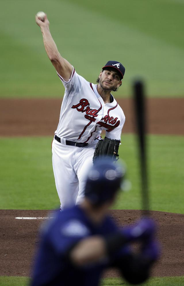 Atlanta Braves starting pitcher Brandon Beachy (37) faces a Colorado Rockies batter in the first inning of a baseball game in Atlanta, Monday, July 29, 2013. Beachy was making his first start of the season after having off-season elbow surgery. (AP Photo/John Bazemore)