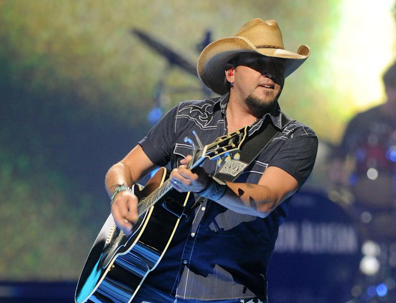 """FILE - This Sept. 21, 2012 photo shows country singer Jason Aldean performing at the iHeart Radio Music Festivalat the MGM Grand Arena in Las Vegas. Aldean has apologized to fans after pictures of him acting """"inappropriately"""" last week popped up. Aldean's apology tweet comes after photos appeared showing him and former """"American Idol"""" contestant Brittany Kerr together at a bar in Los Angeles last Wednesday. In one photo, they appear to kiss. Aldean is married with two children. A publicist says there will be no further comment. (Photo by Eric Reed/Invision/AP, file)"""