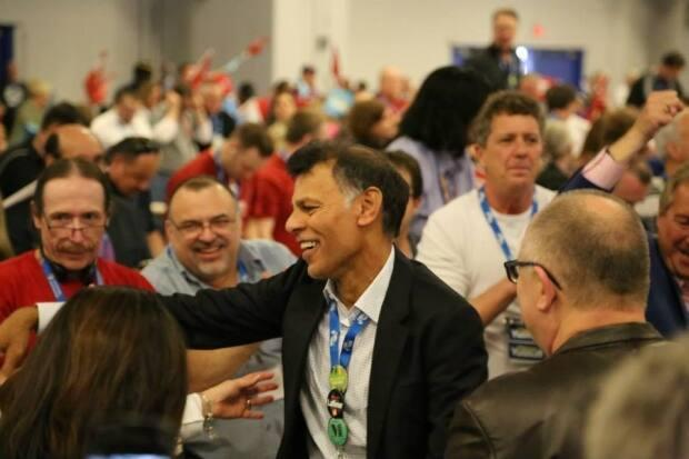Hassan Yussuff, centre, is retiring as president of the Canadian Labour Congress. (Hassan Yussuff/Facebook - image credit)
