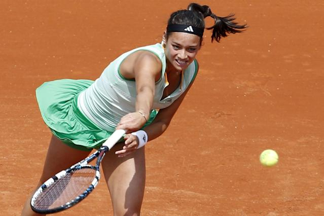 France's Alize Lim serves the ball during the first round match of the French Open tennis tournament against Serena Williams of the U.S. at the Roland Garros stadium, in Paris, France, Sunday, May 25, 2014. (AP Photo/Darko Vojinovic)