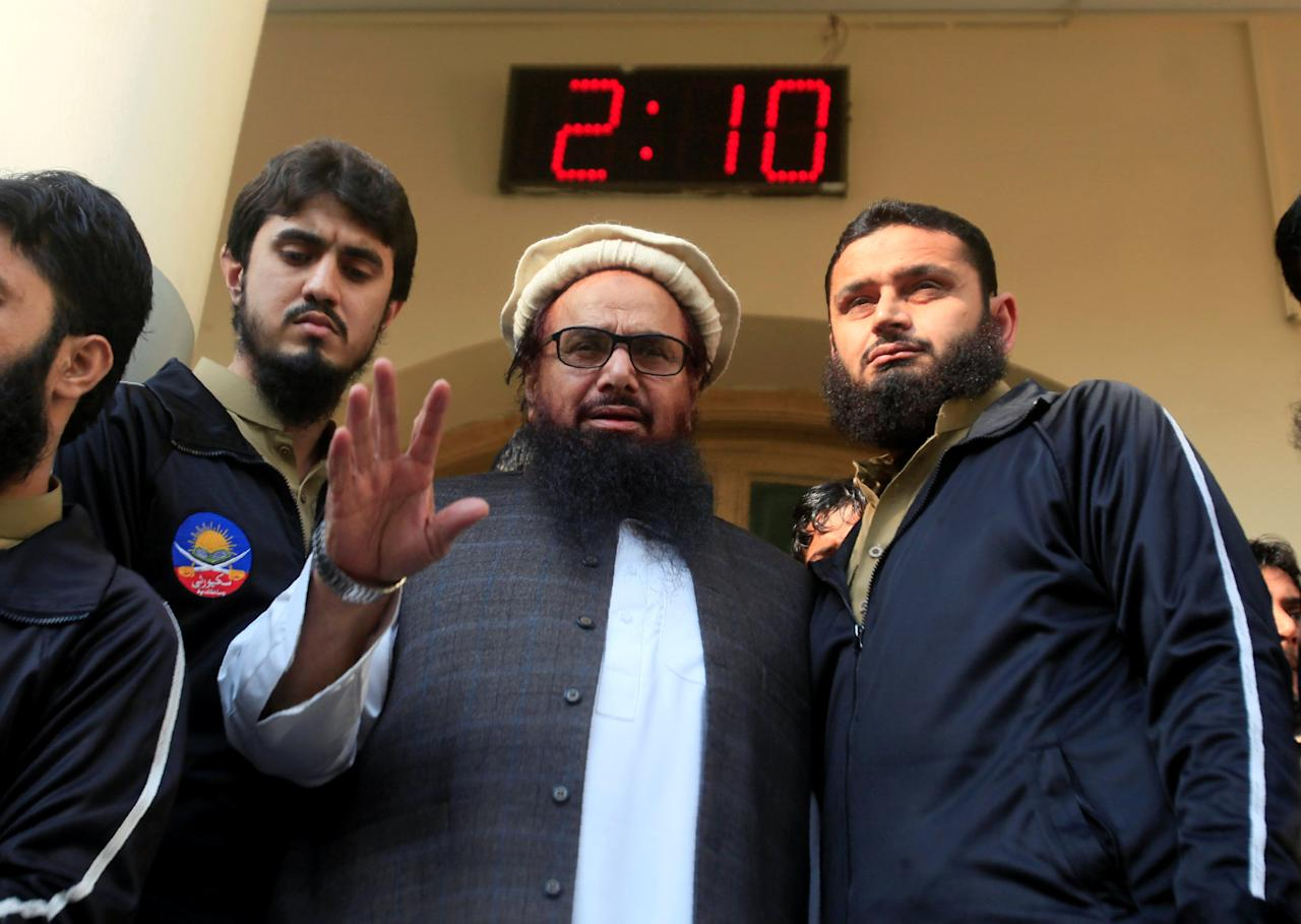 Hafiz Saeed speaks with supporters after attending Friday Prayers in Lahore, Pakistan November 24, 2017. REUTERS/Mohsin Raza