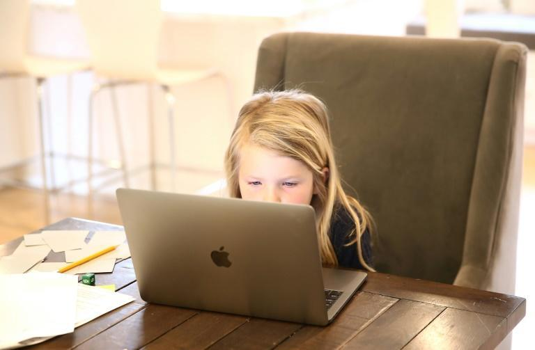 Evianna Van Santvoord, a kindergarten student, follows online courses at home on March 18, 2020 in San Anselmo, California