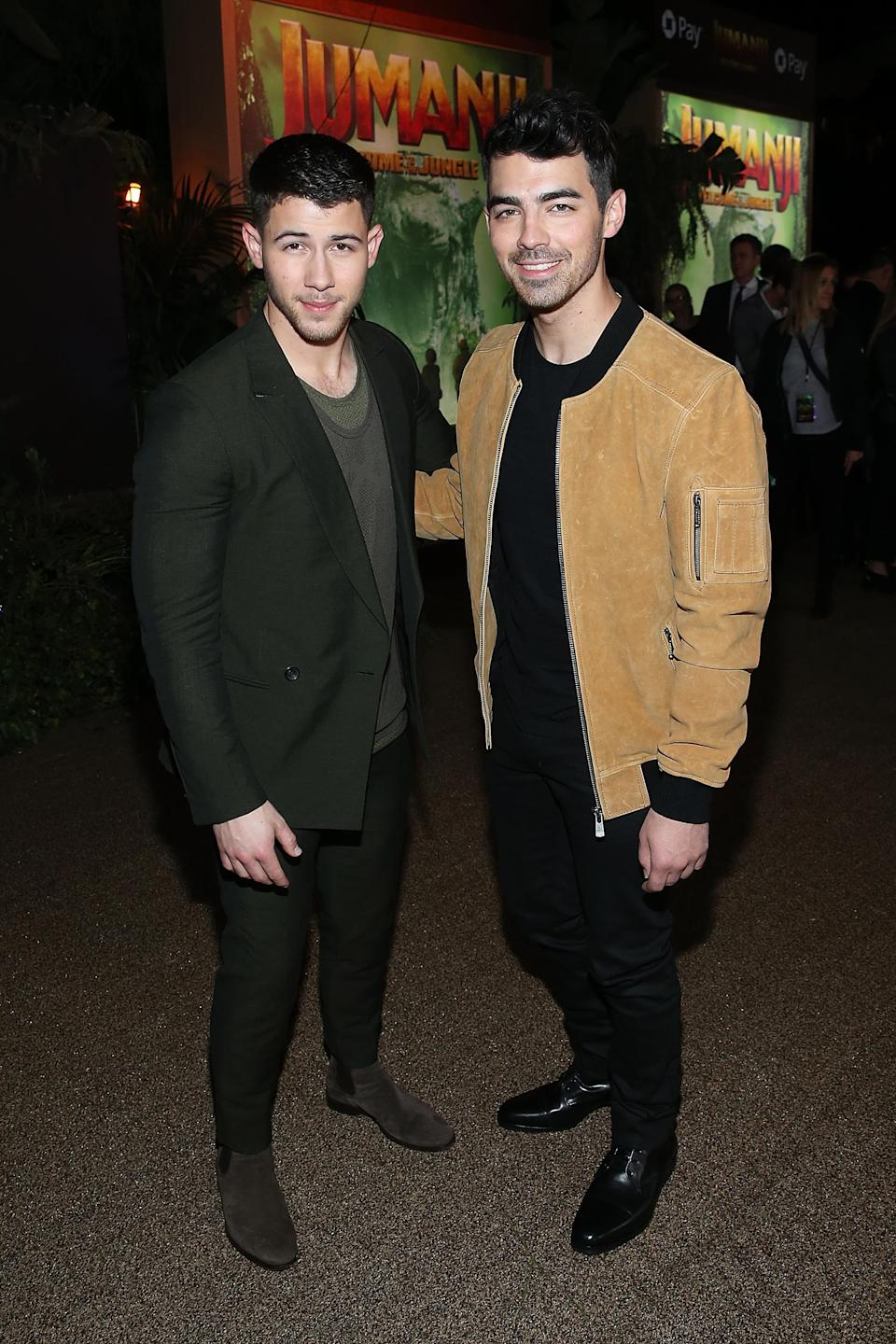 Nick Jonas was joined by his brother Joe, who recently became engaged to Sophie Turner, at the L.A. premiere of <i>Jumanji: Welcome to the Jungle</i> on Dec. 11. (Photo: Phillip Faraone/Getty Images)
