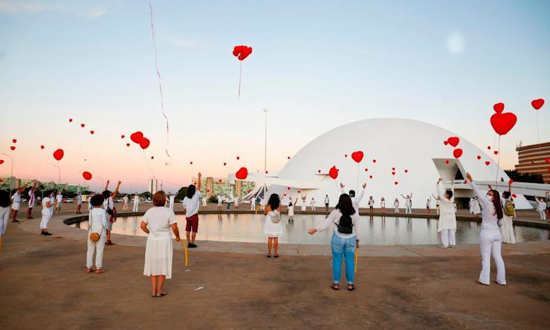 Artists in Brasilia protesting against the Brazilian government's handling of the crisis.