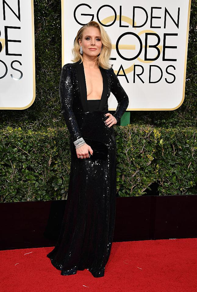 <p>Kristen Bell's dress featured a creative neckline that showed off most of her chest. (Photo: Getty Images) </p>