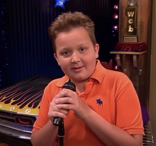 Gibby speaking into a mic