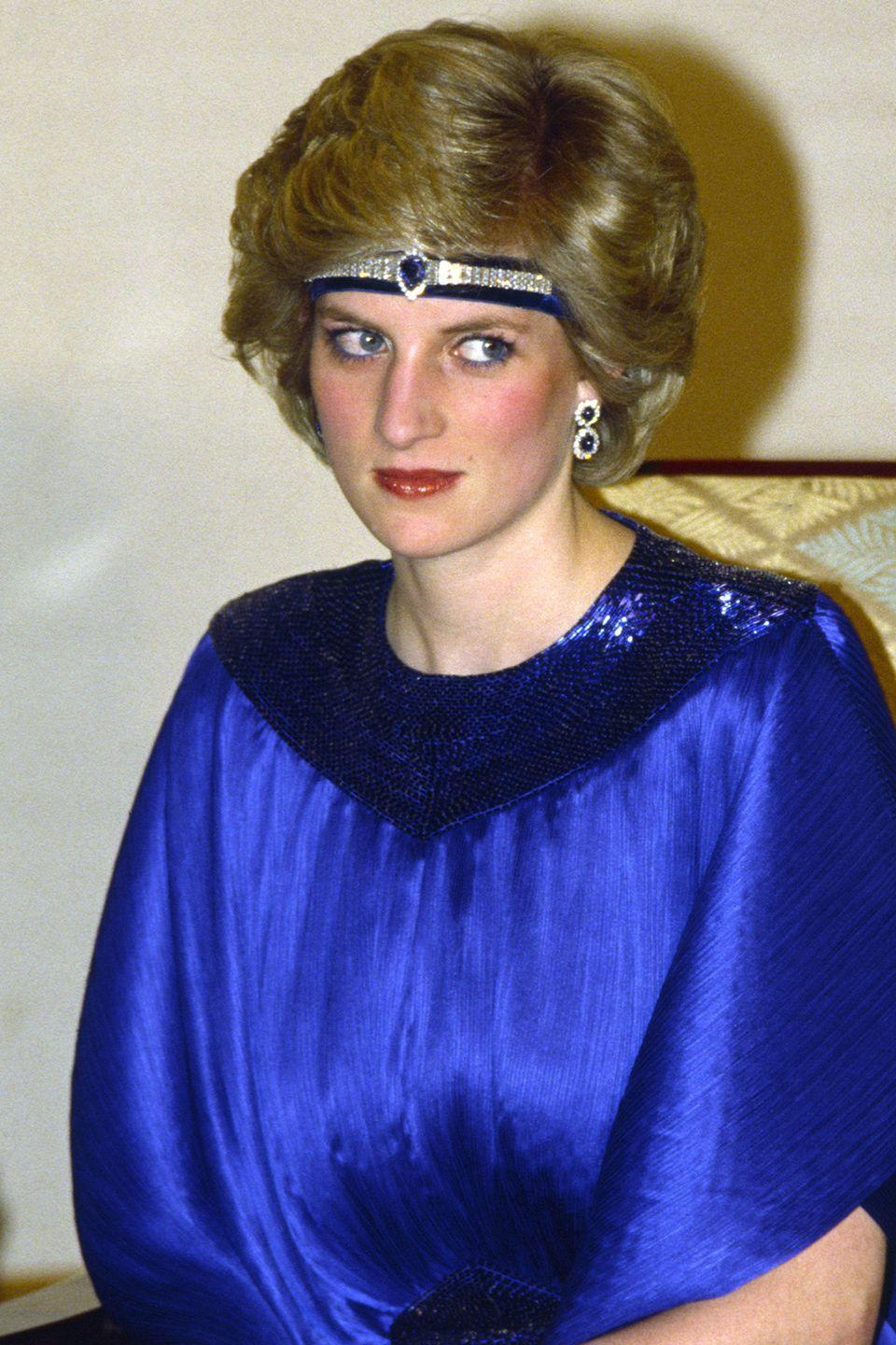 <p>Wearing a diamond and sapphire headband across her forehead and under her hair at a dinner hosted by Emperor Hirohito while on a visit to Japan. </p>