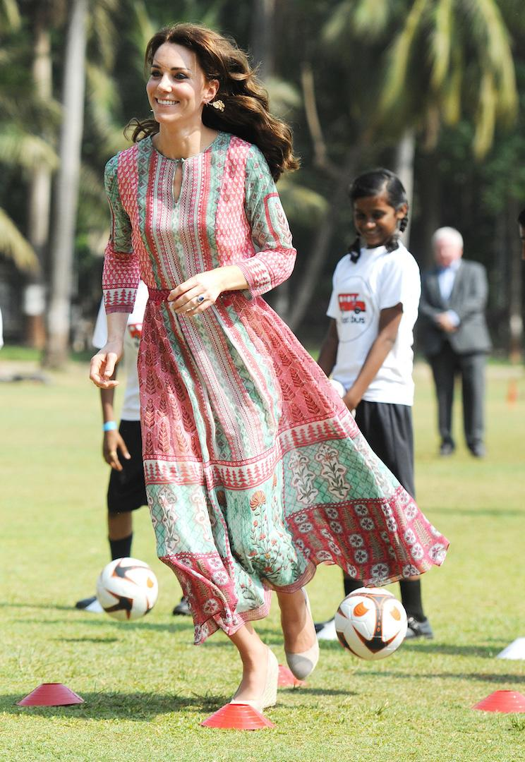 Dressed to play cricket at Mumbai's famous Oval Maidan cricket park, the Duchess of Cambridge wore a dress by local designer Anita Dongre. <em>[Photo: Getty]</em>