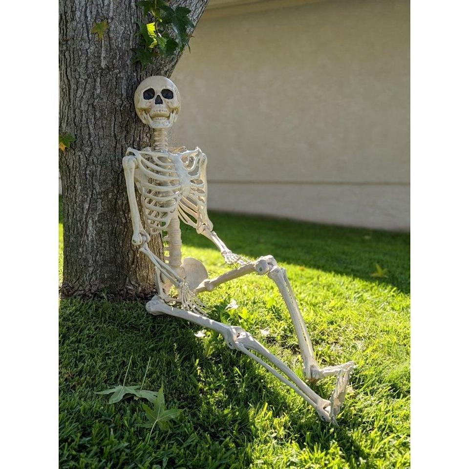 <p>You can't go wrong with this five-foot <span>Way to Celebrate Halloween Hanging Posable Skeleton Decoration</span> ($29). Let it sit at your dining table or on an accent chair indoors. Hang it outside from a tree or let it lean against your porch stairs.</p>