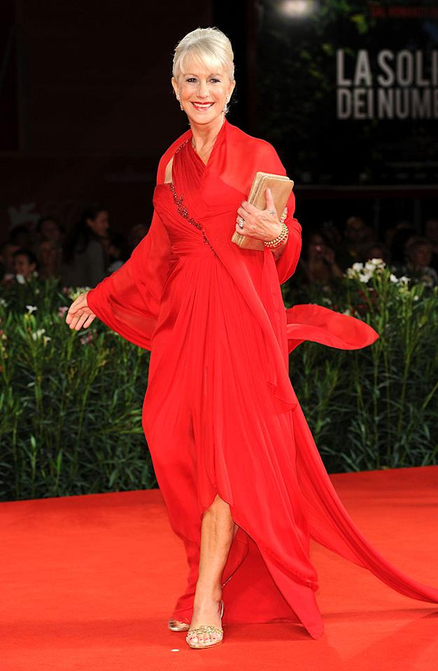 """Meanwhile at the 67th Venice International Film Festival, 65-year-old Dame Helen Mirren caused a ruckus when she hit the arrivals line for the world premiere of """"The Tempest"""" in a draped Marchesa masterpiece, chic updo, and gold sandals. Venturelli/<a href=""""http://www.wireimage.com"""" target=""""new"""">WireImage.com</a> - September 11, 2010"""