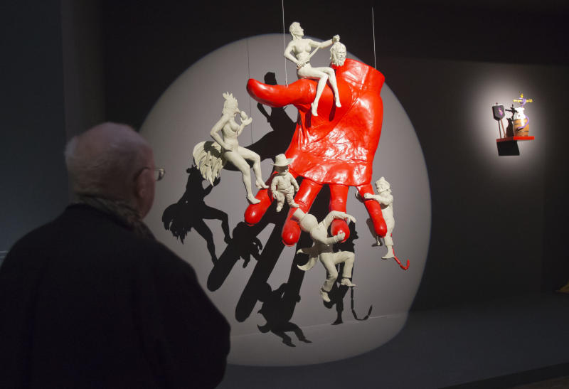 In this photo taken Tuesday, Oct. 29, 2013, a man looks at a sculpture entitled 'a la main du diable, 2013' by French artist Arnaud Labelle-Rojoux, during a press viewing for the exhibition 'Surrealism and the object', at the Pompidou Center in Paris. The exhibition at Paris' Pompidou Center tells the previously untold story of how the Surrealists managed to reconcile their fantastical dreams and Marxist politics by channeling their artistic message through everyday objects. The exhibition runs from Oct. 30, 2013 until March 3, 2014. (AP Photo/Michel Euler)