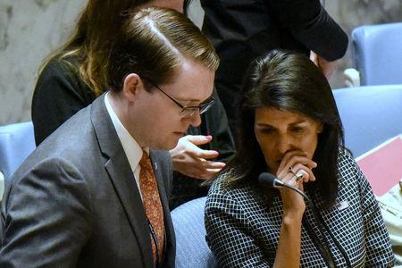 U.S. Ambassador to the U.N. Nikki Haley speaks with an aid before a Security Council meeting on the situation in Syria at the United Nations Headquarters in New York