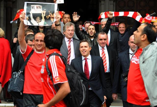 Martin Broughton, (middle centre) and managing director Christian Purslow (front centre) land Ian Ayre (right) were the key figures in pushing through the sale of Liverpool in 2010