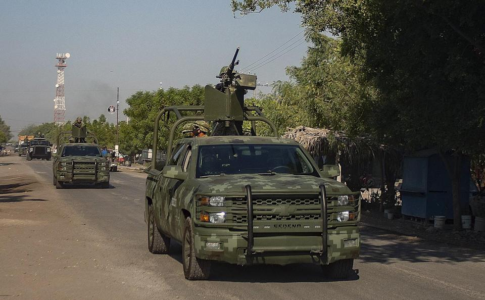 A convoy of vehicles from the Mexican Army patrol during the visit of Monsignor Franco Coppola in Aguililla, Mexico