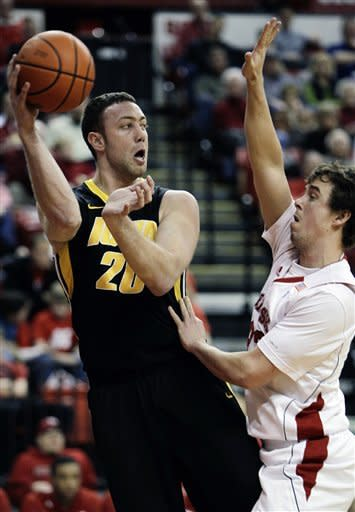 Iowa's Andrew Brommer (20) passes against Nebraska's Mike Fox during the first half of their NCAA college basketball game in Lincoln, Neb., Wednesday, Feb. 29, 2012. (AP Photo/Nati Harnik)