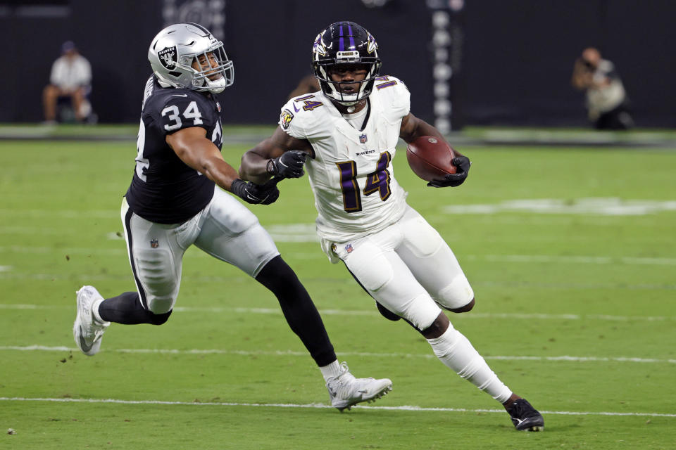 LAS VEGAS, NEVADA - SEPTEMBER 13: Sammy Watkins #14 of the Baltimore Ravens runs for yardage after catching a pass against past K.J. Wright #34 of the Las Vegas Raiders at Allegiant Stadium on September 13, 2021 in Las Vegas, Nevada. (Photo by Ethan Miller/Getty Images)
