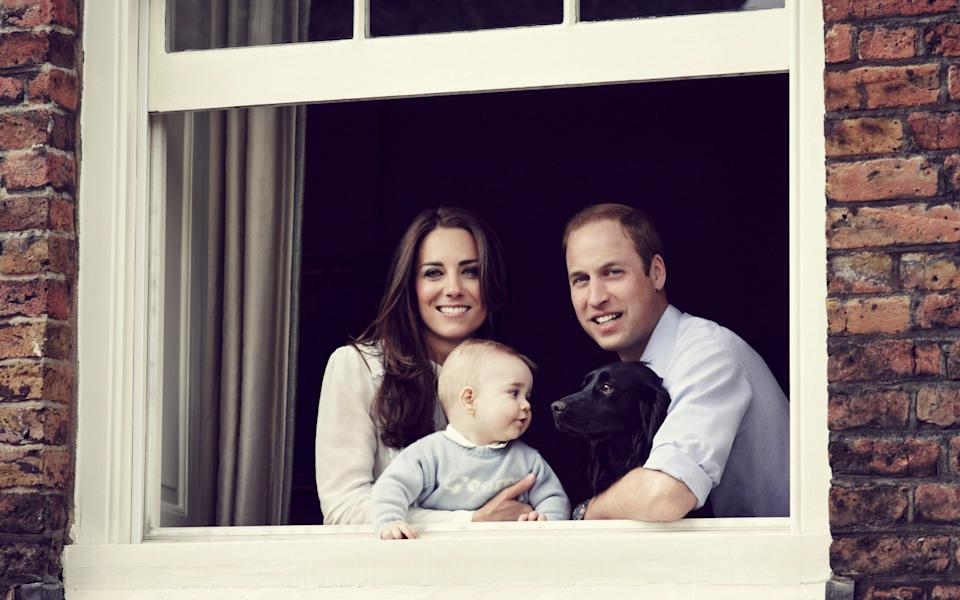 The Duke and Duchess of Cambridge, along with Prince George and Lupo in 2014 - Getty Images