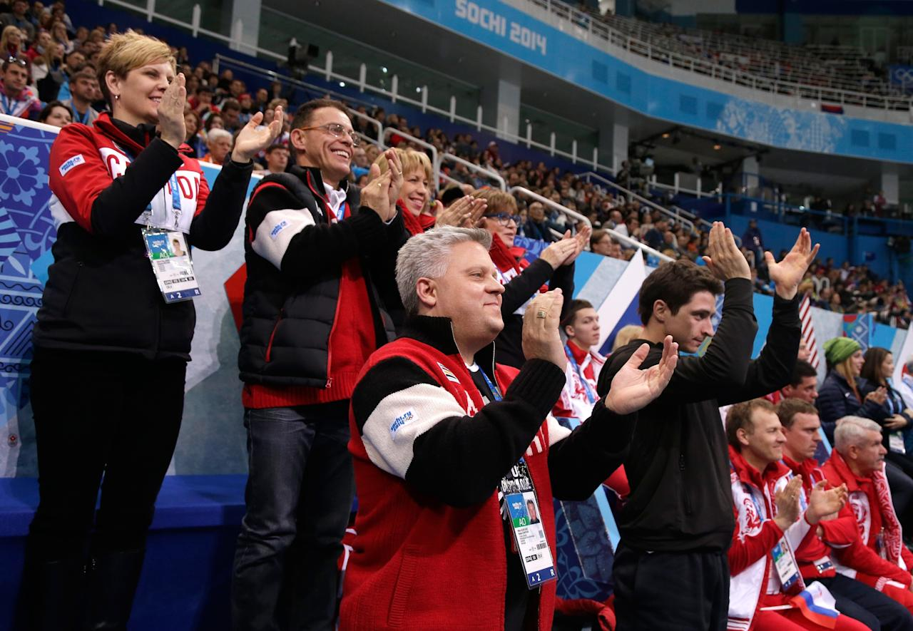 SOCHI, RUSSIA - FEBRUARY 08: The Canada figure skating team and coaches cheer as Kirsten Moore-Towers and Dylan Moscovitch of Canada compete in the Figure Skating Team Team Pairs Free Skating during day one of the Sochi 2014 Winter Olympics at Iceberg Skating Palace on February 8, 2014 in Sochi, Russia. (Photo by Darren Cummings/Pool/Getty Images)
