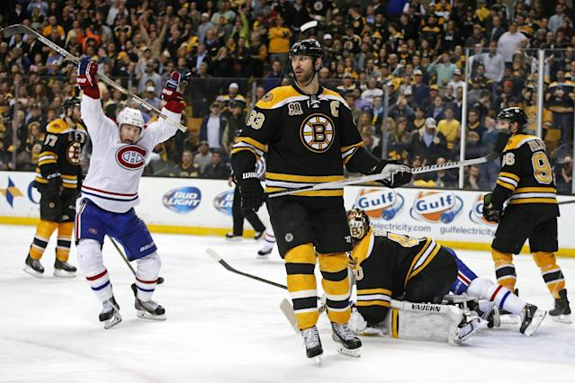 Montreal Canadiens right wing Brendan Gallagher, left, celebrates his teammate P.K. Subban's game-winning goal in the second overtime period as Boston Bruins defenseman Zdeno Chara (33) skates near in Game 1 of an NHL hockey second-round playoff series in Boston, Thursday, May 1, 2014. (AP Photo/Elise Amendola)
