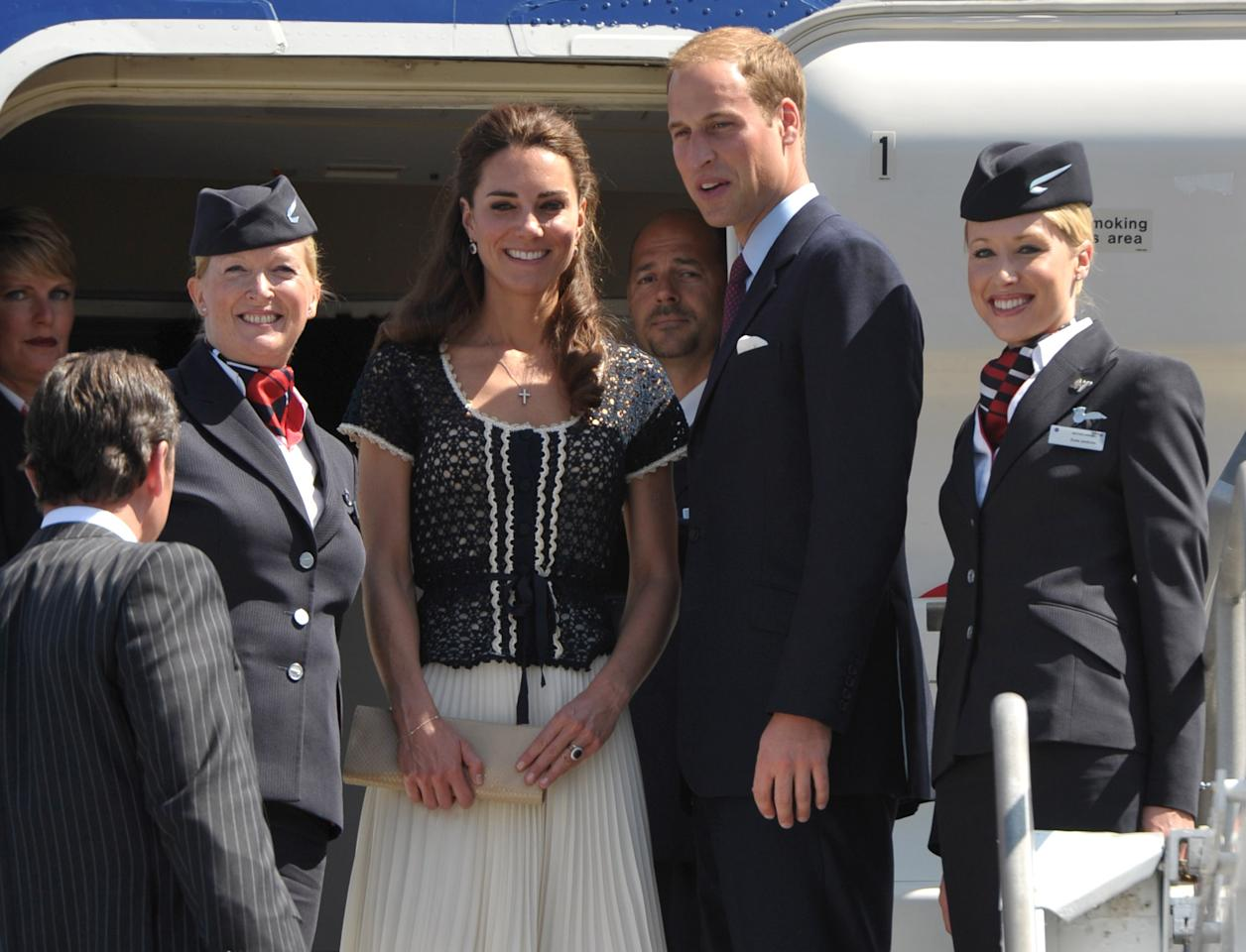 Prince William and Kate, the Duke and Duchess of Cambridge, prepare for their departure at Los Angeles International Airport on Sunday, July 10, 2011, in Los Angeles. Following a nonstop weekend that included a few chukkas of polo, time with Hollywood's own version of royalty and several events that raised millions for charity, Prince William and his wife, Kate, the Duke and Duchess of Cambridge headed back to the U.K. on Sunday. (AP Photo/John Shearer, Pool)