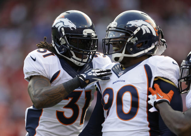 Denver Broncos outside linebacker Shaun Phillips, right, is greeted by teammate Omar Bolden, left, after scoring a touchdown on a fumble recovery during the second quarter of an NFL preseason football game on Thursday, Aug. 8, 2013, in San Francisco. (AP Photo/Ben Margot)