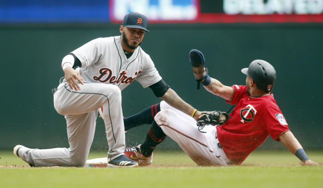 Minnesota Twins' Eddie Rosario, right, beats the tag by Detroit Tigers second baseman Harold Castro to steal second base in the third inning of a baseball game Saturday, May 11, 2019, in Minneapolis. (AP Photo/Jim Mone)