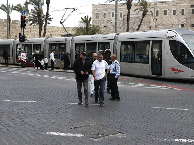 Israeli security forces gathering at the site where a British woman was killed on the light rail near Jerusalem's Old City (Ahmad Gharabli/Getty Images)