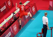 <p>TOKYO, JAPAN - JULY 28: Maxim Mikhaylov #17 of Team ROC falls into the boards as he competes against Team Brazil during the Men's Preliminary Round - Pool B volleyball on day five of the Tokyo 2020 Olympic Games at Ariake Arena on July 28, 2021 in Tokyo, Japan. (Photo by Toru Hanai/Getty Images)</p>