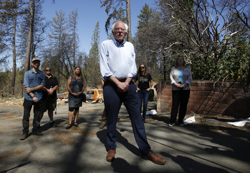 Democratic presidential candidate Sen. Bernie Sanders, I-Vermont, talks to reporters as he tours a mobile home park that was destroyed by last year's wildfire in Paradise, Calif., Thursday, Aug. 22, 2019.  Sanders released a $16.3 trillion climate plan Thursday that builds on the Green New Deal and calls for the United States to move to renewable energy across the economy by 2050 and declare climate change a national emergency.   (AP Photo/Rich Pedroncelli)