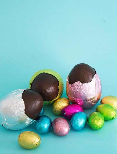 This image taken on March 9, 2013 shows faux chocolate eggs made by painting papier-mâché forms and wrapping them in colored foil in Concord, N.H. (AP Photo/Holly Ramer)