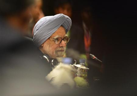 Prime Minister Manmohan Singh delivers his opening speech at the 11th ASEAN-India Summit in Bandar Seri Begawan, October 10, 2013. REUTERS/Ahim Rani/Files