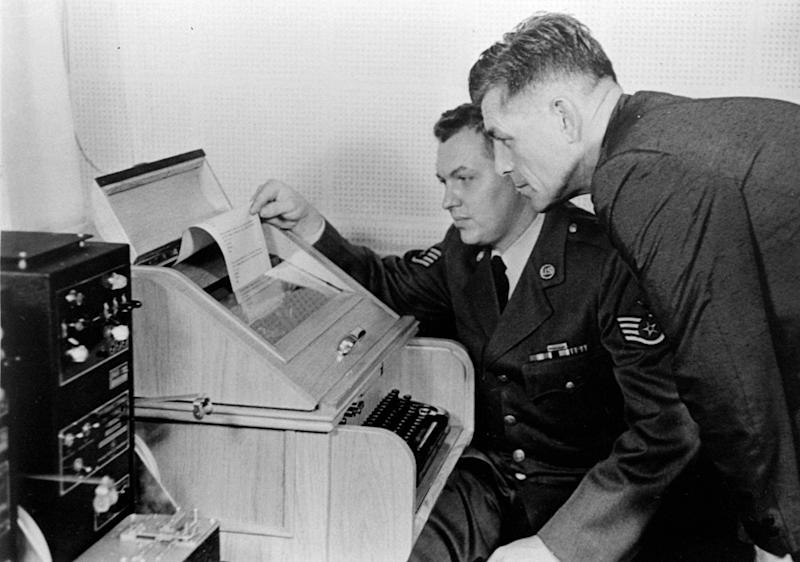 """FILE - This Aug.30, 1963 black-and-white file photo shows the White House Kremlin """"hot line"""" providing direct communication for emergency use by the Chief of Staff in Washington and Moscow, becaming operational. Air Force Sgt. John Bretoski, left, and Army Lt. Col. Charles Fitzgerald, man the equipment in the Pentagon during a test run. The Pentagon is the U.S. operating terminal for both the land line-transocean circuit and the alternate radio circuit, with a direct relay to the White House. The Washington-Moscow Hot Line, used by U.S. and Russian leaders for frank discussions about crises including the 1967 Six-Day War and the Soviet Union's 1979 invasion of Afghanistan, marks its 50th birthday Thursday with the nations still grappling with competing interests in regional conflicts. (AP Photo, File)"""