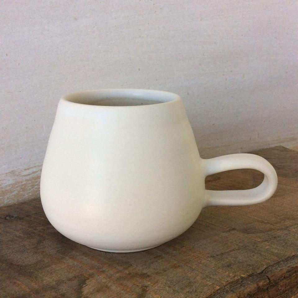 """<p>Every coffee or tea drinker can appreciate the small indulgence of drinking from a beautifully crafted piece of pottery. This <span>'70s mug</span> ($55) from cult favorite <a href=""""https://jeredspottery.myshopify.com/"""" class=""""link rapid-noclick-resp"""" rel=""""nofollow noopener"""" target=""""_blank"""" data-ylk=""""slk:Jered's Pottery"""">Jered's Pottery</a> not only looks chic, but actually helps liquid stay piping hot, too. The California clay material also retains heat without burning your hands and is dishwasher- and microwave-safe. </p>"""