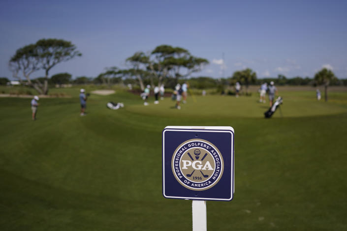 Players putt on the third hole during a practice round at the PGA Championship golf tournament on the Ocean Course Tuesday, May 18, 2021, in Kiawah Island, S.C. (AP Photo/David J. Phillip)
