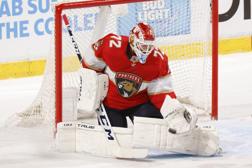 Florida Panthers goaltender Sergei Bobrovsky (72) makes a glove save against the Tampa Bay Lightning during the second period in Game 1 of an NHL hockey Stanley Cup first-round playoff series, Sunday, May 16, 2021, in Sunrise, Fla. (AP Photo/Joel Auerbach)