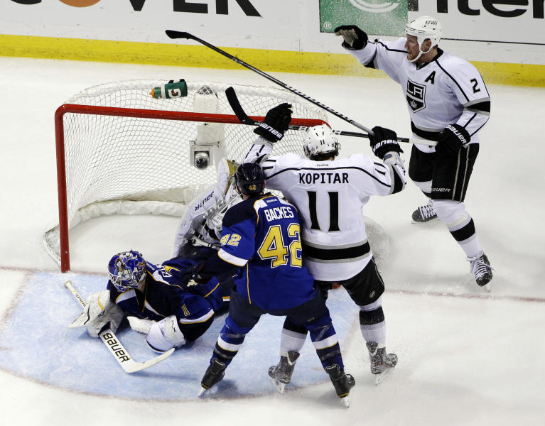 Los Angeles Kings' Matt Greene (2) celebrates after scoring past St. Louis Blues goalie Brian Elliott, left, as David Backes (42) and Kings' Anze Kopitar, of Slovenia, watch during the second period of Game 1 in a second-round NHL Stanley Cup hockey playoff series, Saturday, April 28, 2012, in St. Louis. (AP Photo/Jeff Roberson)