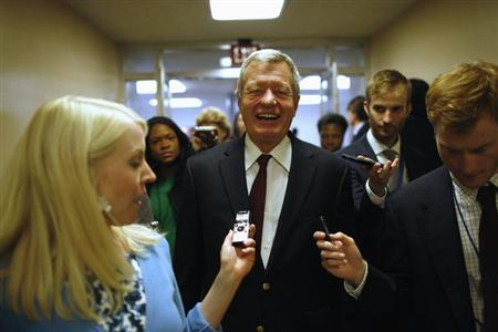 U.S. Senator Baucus talks to reporters after the Senate passed a spending bill to avoid a government shutdown at the U.S. Capitol in Washington