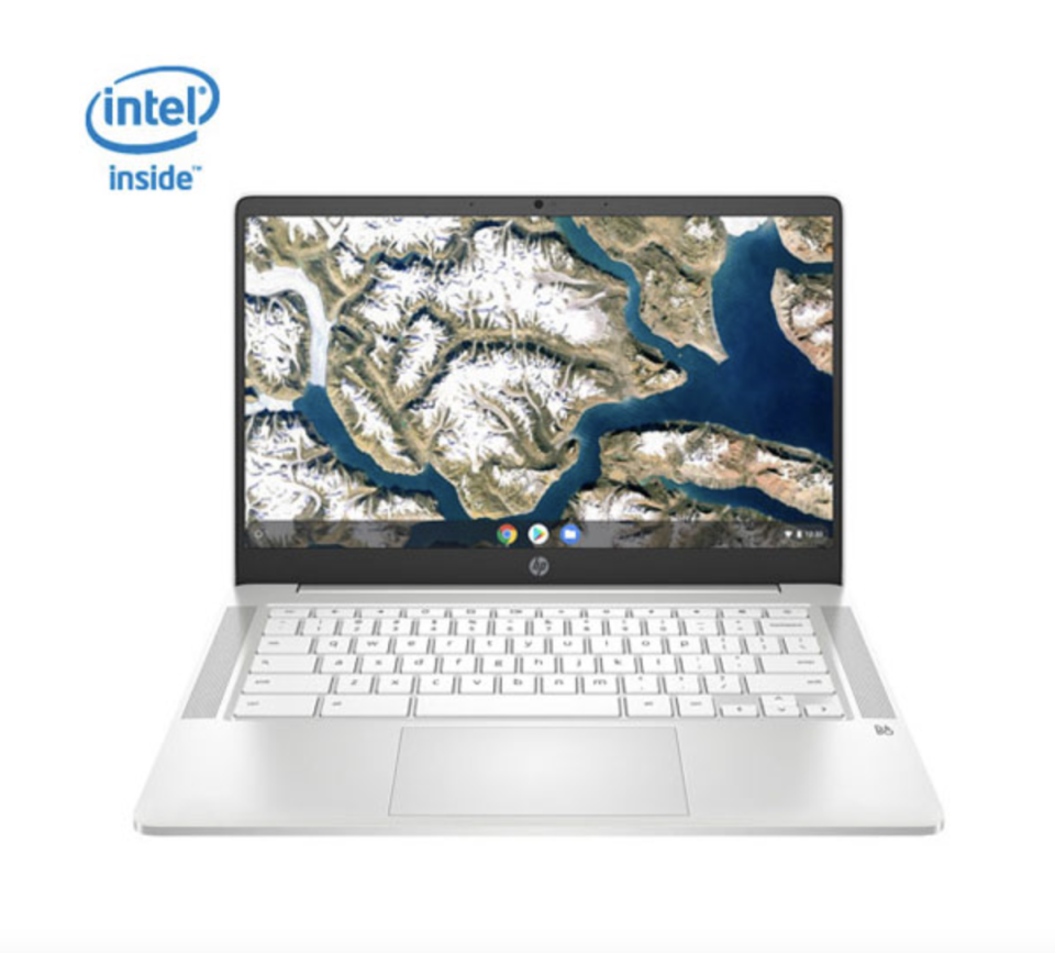 hp laptop with earth background on screen and white keyboard