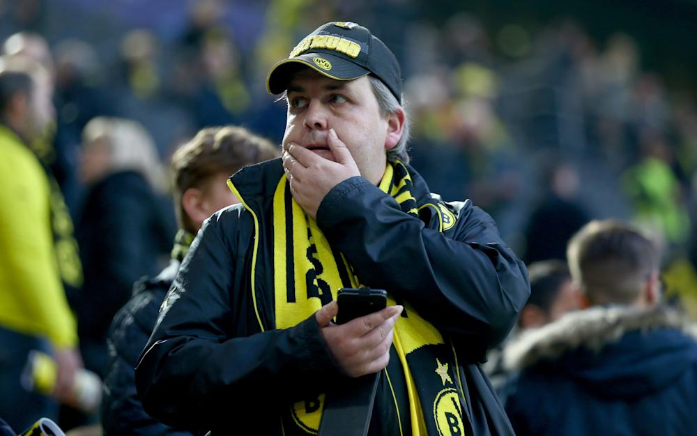 A fan of Dortmund looks concerned of the bomb attack to the bus of Borussia Dortmund prior to the UEFA Champions League Quarter Final first leg match between Borussia Dortmund and AS Monaco - Credit: Christof Koepsel/Bongarts/Getty Images