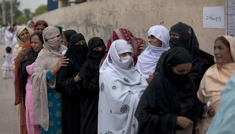 Women voters stand in a queue outside a polling station in Islamabad, Pakistan on Saturday, May 11, 2013. Despite a bloody campaign marred by Taliban attacks, Pakistan was holding historic elections Saturday pitting a former cricket star against a two-time prime minister once exiled by the army and an incumbent blamed for power blackouts and inflation. (AP Photo/B.K. Bangash)