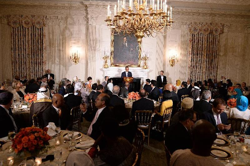 US President Barack Obama speaks as he hosts an Iftar dinner in the State Dinning Room at the White House in Washington on July 14, 2014