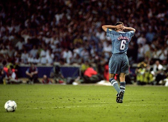 Gareth Southgate stands with his hands behind his head after missing a penalty