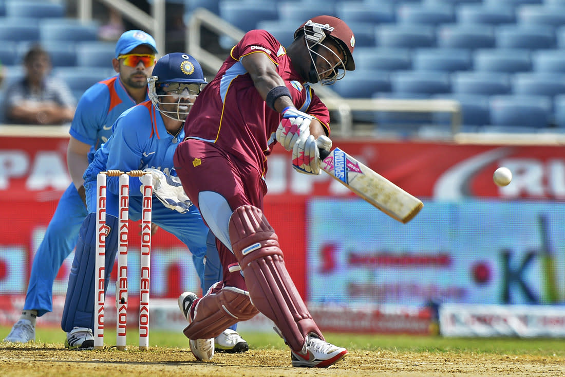 West Indies cricketer Darren Bravo plays a shot during the second match of the Tri-Nation series between Indian and West Indies at the Sabina Park stadium in Kingston on June 30, 2013. India have scored 229/7 at the end of their innings. AFP PHOTO/Jewel Samad