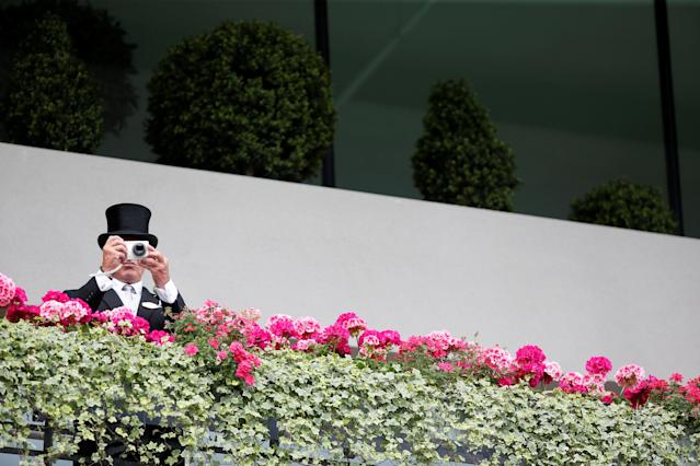 Horse Racing - Royal Ascot - Ascot Racecourse, Ascot, Britain - June 24, 2017 A racegoer takes a photograph Action Images via Reuters/Matthew Childs TPX IMAGES OF THE DAY