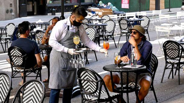 PHOTO: An outdoor dining area is seen as the city continues Phase 4 of re-opening following restrictions imposed to slow the spread of coronavirus on July 27, 2020 in New York City. (Jamie McCarthy/Getty Images)